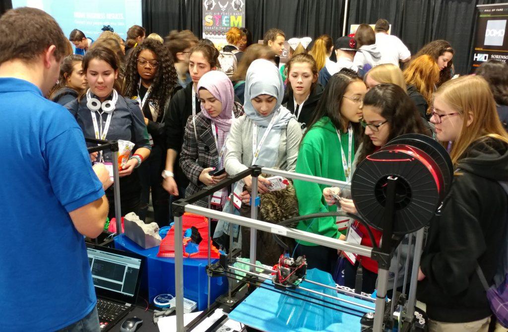 High School girls watch ReliaBuild 3D printing.